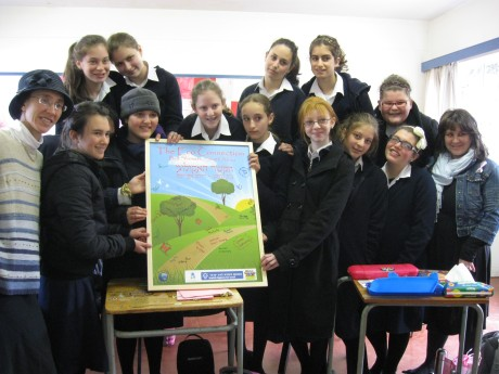 Torah Academy Girls sign their Partnership Poster